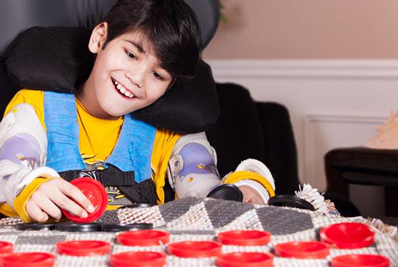 hispanic boy playing chess